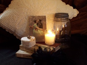 Photo of several objects including  a candle, jar, and ring.